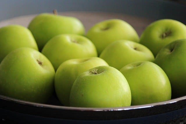 Heat slices of granny smith apples with a touch of cinnamon and brown sugar for a quick healthy snack