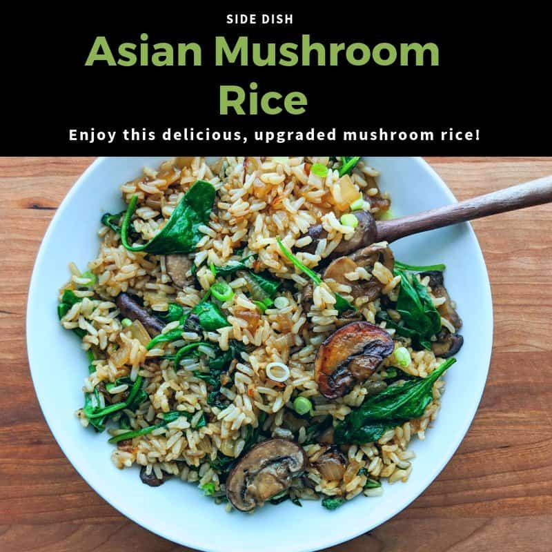 Asian Mushroom Rice with sauteed onions cloves and spinach served in a white bowl on a wood background