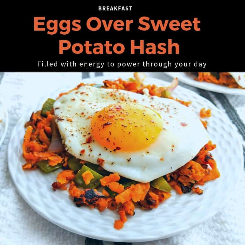 Fried egg over sweet potatoes, peppers and onions