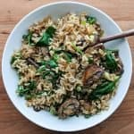 Asian mushroom rice with spinach served on a white dish