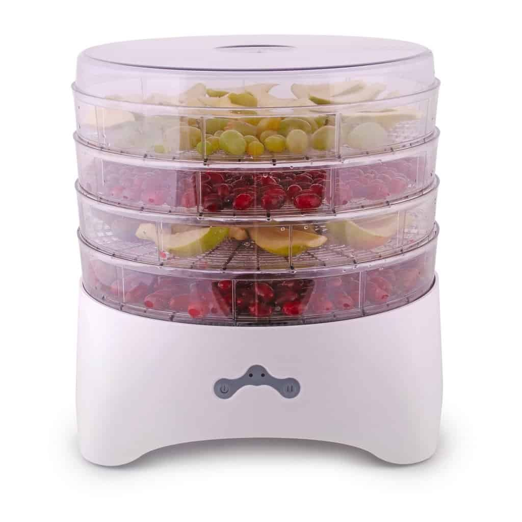 White and clear stackable food dehydrator with grapes, apples, and cherries on differnt sections.