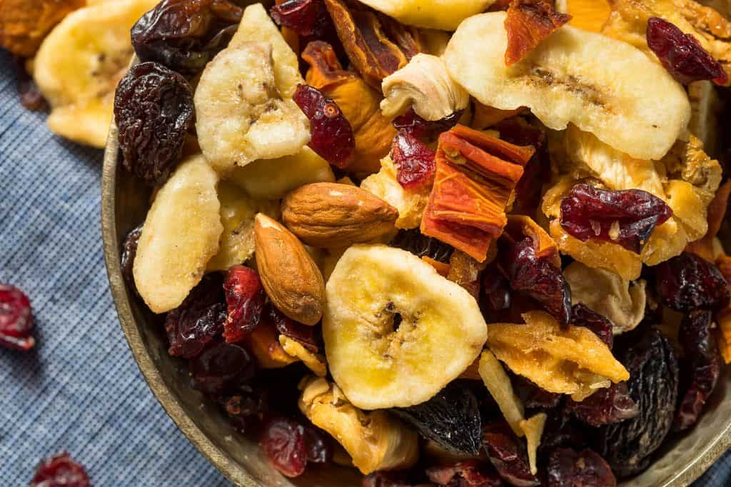 Dried bananas, raisens, crandberries figs and nuts in a bowl