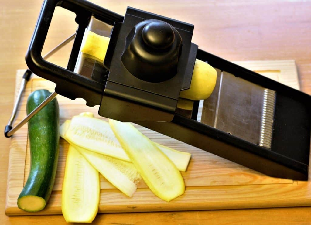 slicing squash with a mandolin