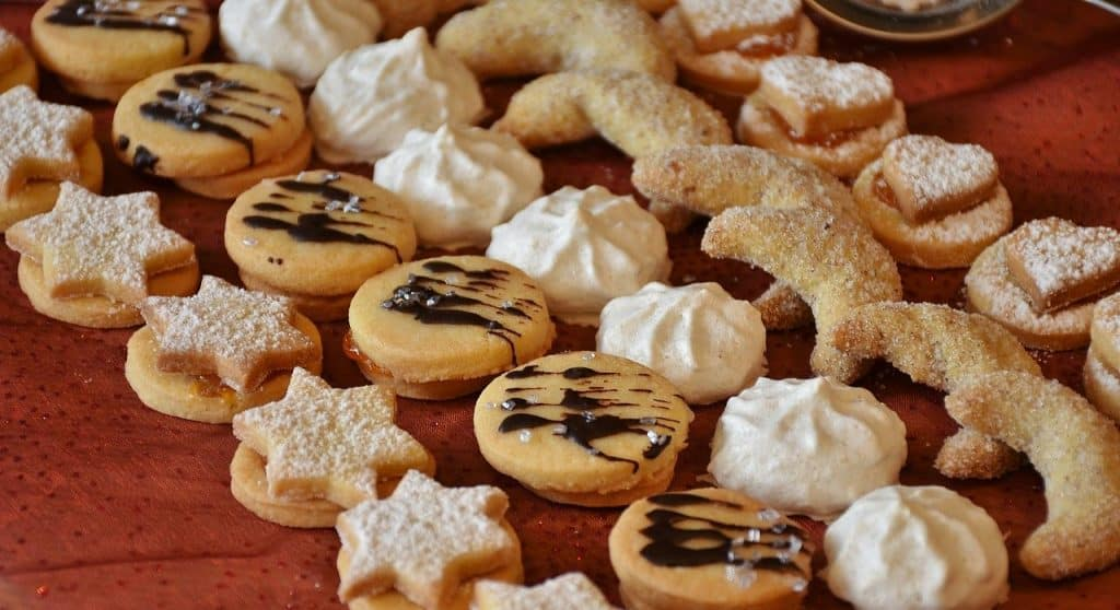 rows of holiday cookies on a tray