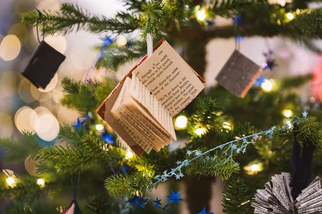 Christmas tree decorated with old books and newspapers.