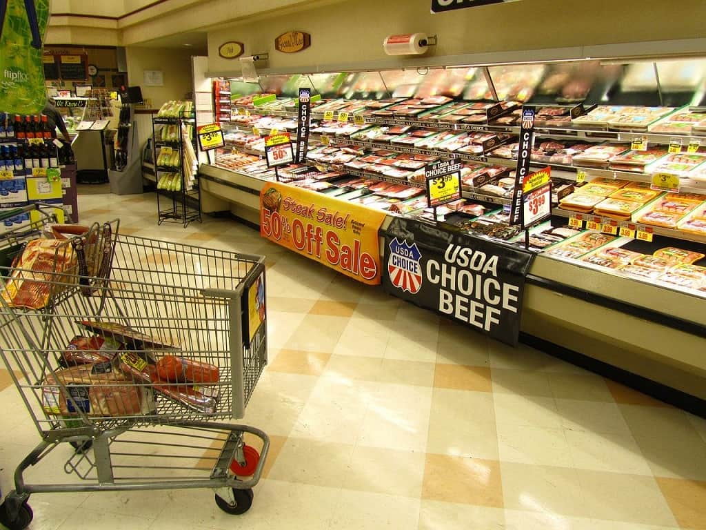 meat isle at the grocery store with big 50% off sale