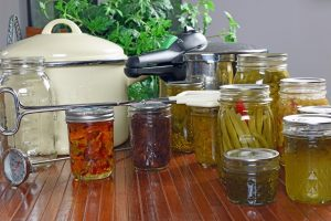 table with canning supplies and vegetables