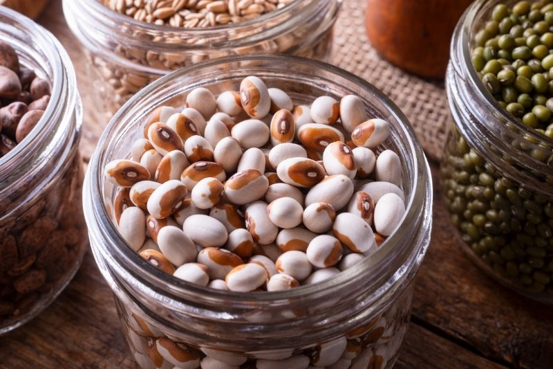 Yellow eyed white beans in a glass storage jar